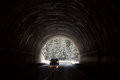 Car entering in a tunnel with forest in background with snow Royalty Free Stock Photo