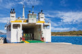 Car ferry boat with door open to load cars Stock Photography