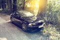 Car on forest road bmw e ci view of a german modern black Royalty Free Stock Photography