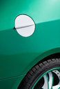 Car fuel tank lid white green closeup Royalty Free Stock Photo