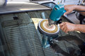 Car Glass polishing with power buffer machine Stock Images