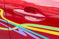 Car handle close up red vehicle door with Royalty Free Stock Image