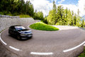 Car having fun on a twisty road in the Jaufenpass (Passo Giovo), Italy Royalty Free Stock Photo