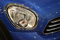 Car headlight closeup of on blue Stock Image