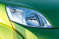 Car headlight closeup of a new green Royalty Free Stock Photos