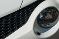 Car headlight closeup white nissan juke Royalty Free Stock Images