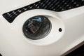 Car headlight closeup white nissan juke Stock Image