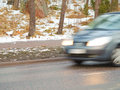 Car in high speed captured with blury motion on wintry conditions Royalty Free Stock Images