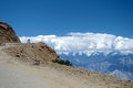 A car on Himalayas Khardung La pass high altitude road. Royalty Free Stock Photo