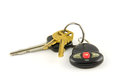 Car and house keys with keychain alarm transmitter Royalty Free Stock Photo