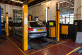 Car inspection in automotive service bays garage Royalty Free Stock Image