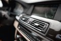 Car interior with close-up of ventilation system holes and air conditioning. Concept wallpaper for auto air conditioning an Royalty Free Stock Photo