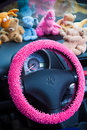 Car interior, with pink details. Royalty Free Stock Photo