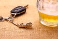 Car key with accident and beer mug close up Royalty Free Stock Image