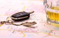 Car key with accident and beer mug on map close up Stock Photography