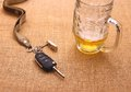 Car key with accident and beer mug top view Stock Images