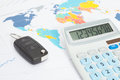 Car key with calculator over print with world map series Royalty Free Stock Photo