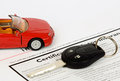 Car key on an insurance document image of a Royalty Free Stock Photo