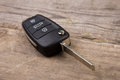 Car key with remote alarm control on the wooden desk Royalty Free Stock Photo