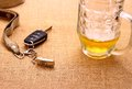 Car key with a tilted trailer and beer mug close up Royalty Free Stock Photography