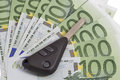 Car keys on 100 Euro bills background Royalty Free Stock Photo