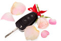 Car keys with ribbon and flowers as a gift isolated on white background Royalty Free Stock Photos