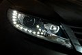Car led headlight closeup photo of a black s Stock Images