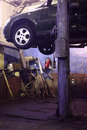 Car on lift in  workshop Royalty Free Stock Photo
