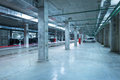 Car lights in the big underground city parking. Royalty Free Stock Photo