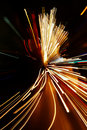 Car lights in motion blur with zoom effect Royalty Free Stock Photo