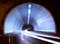 Car lights in a tunnel, city at night. Royalty Free Stock Photo