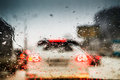 Car lights through the wet windshield street in rush hour bokeh abstract background small depth of sharpness Royalty Free Stock Images