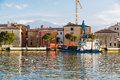 Car loading onto ferry in venice an old a canal with driving rear Royalty Free Stock Photo