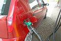 Car makes a supply of green unleaded fuel Royalty Free Stock Photo