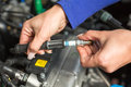 Car mechanic changing spark plugs Royalty Free Stock Photos