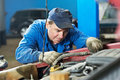 Car mechanic diagnosing auto engine problem Stock Photos