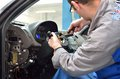 Car mechanic disassemble the steering car column work day inside auto service detailed work on parts components Stock Photography