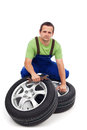 Car mechanic with new tires Royalty Free Stock Photography