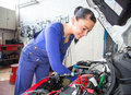 Car mechanic repairing automobile garage workshop Stock Photo