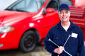 Car mechanic  with tire wrench. Royalty Free Stock Photo