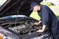 Car mechanic working in auto repair service professional Stock Image