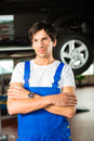 Car mechanic in workshop Stock Photos