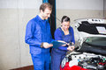 Car mechanics repairing car electrics other parts motor Stock Photography
