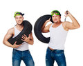 Car mechanics with tires and wrench Royalty Free Stock Photo