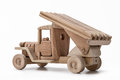 The car is a military toy car made of wood.