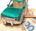 Car on money representing concept of expenses or expansive Royalty Free Stock Image
