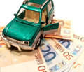Car on money representing concept of expenses or expansive Royalty Free Stock Photos