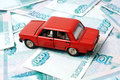 Car and money toy on the background of banknotes Stock Images