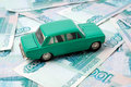 Car and money toy on the background of banknotes Royalty Free Stock Image