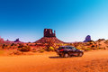 Car on the Monument Valley drive. The Valley Drive is a scenic dirt road through Navajo Tribal Park between Arizona and Utah. Royalty Free Stock Photo